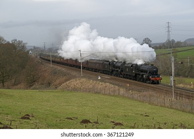 January 23 2016. The inaugural run on its return to the main line by the world famous Flying Scotsman locomotive marred by defects sees former LMS 'Black 5's' replace the failed engine. Shap bank