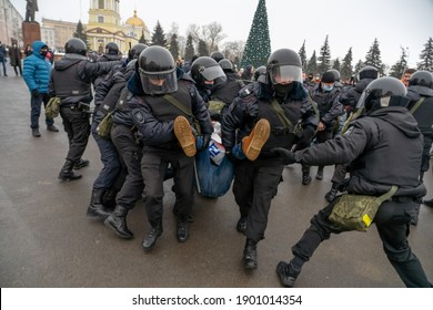"""January 23, 2021, Russia, Lipetsk, Rally in support of Navalny. A man with a poster that says """"You can't hide the truth"""" is harshly detained by the police"""