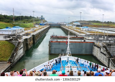 January 28, 2019, Panama Canal, Panama. Tourist on the deck of cruise ship taking pictures and wondering, while ship is entering gates of Panama Canal