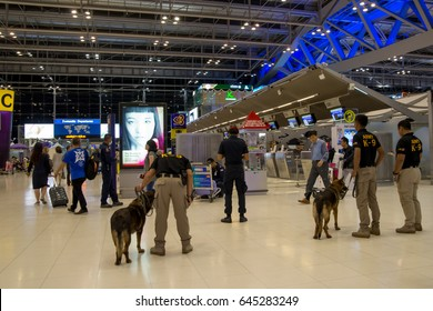 January 29, 2017. An army K9 canine unit investigates a suspicious suitcase left on a trolley at Suvarnabhumi Airport, Bangkok, Thailand. Security and terrorism editorial concept.