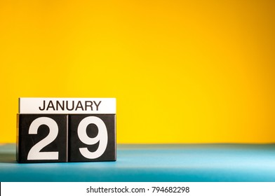 January 29th. Day 29 of january month, calendar on yellow background. Winter time. Empty space for text