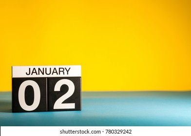January 2nd. Day 2 of january month, calendar on yellow background. Winter time. Empty space for text
