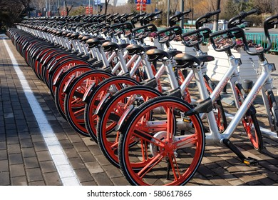 "In January 30, 2017, Ji'nan City, Shandong province China,""mobike"" smart bikes parked neatly in front of the municipal government"