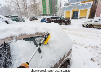 January 31, 2018. Moscow. Russia. A man is cleaning his car from snow after heavy snowfall