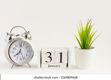 January 31 on a wooden calendar next to the alarm clock.Calendar date, holiday event or birthday.The concept of one day of the month.