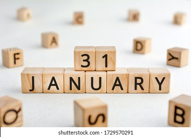 January 31 - from wooden blocks with letters, important date concept, white background random letters around