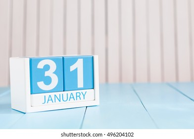 January 31st. Day 31 of month, calendar on wooden background. Winter at work concept. Empty space for text