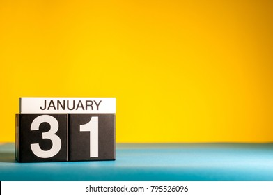 January 31st. Day 31 of january month, calendar on yellow background. Winter time. Empty space for text