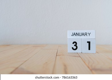 january 31st,January 31 white wooden calendar cube on wood background
