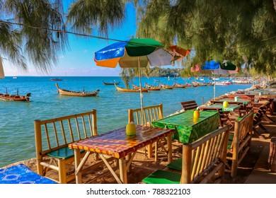January 6, 2016 Rawai Phuket Thailand Traditional longtail tourist boats moored at Rawai Beach