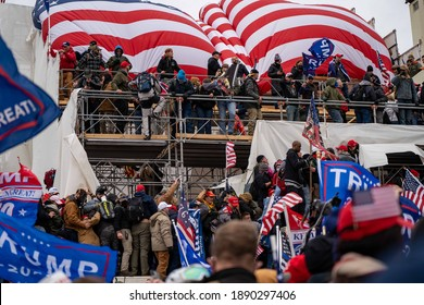 January 6th, 2021 - Capitol Hill, Washington D.C. USA: The trump supporters storming the capitol and climbing on the scaffolding.