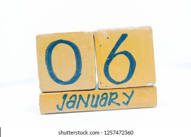 January 6th. Day 6 of month, calendar on wooden background. Winter time, year concept