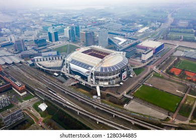 JANUARY 7, 2019, Amsterdam, Netherlands : Aerial Johan Cruyff Arena is the main stadium of AFC Ajax soccer club and Netherlands national football team feat panoramic urban helicopter view in Holland