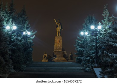 January 7, 2019 Sevastopol, Crimea. Monument to the leader of the proletoreat V.I. Lenin showing with his hand into the distance against the background of lamps, stairs in the night sky. - Shutterstock ID 1854569272