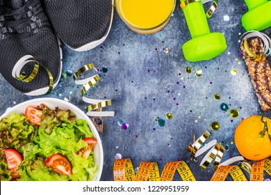 January diet background. Diet or detox before or after Christmas holidays. Bowll of healthy salad, energy bar, juice and fruit on after party background