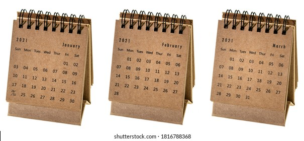January, February and March 2021  - small spiral desktop calendar isolated on white, time and business concept