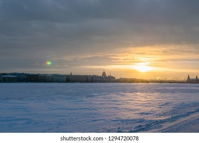 January in Saint Petersburg, Russia .Frozen in extreme cold Neva River and city skyline at sunset