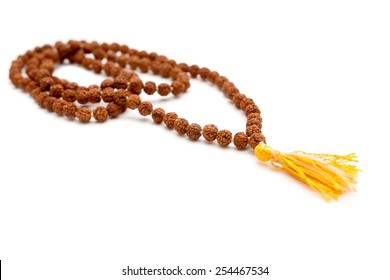 Japa mala. Prayer beads made from the seeds of the rudraksha tree. Isolated on white background