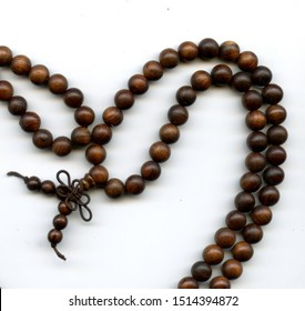 A Japa mala or mala Sanskrit is a string of prayer beads of Hindus, Buddhists, Jains for the spiritual practice rosary of sandalwood beads 108