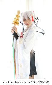 Japan anime cosplay , white japanese miko in white tone room