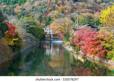 Japan autumn season the beauty of nature and steam travel destination colorful of maple leaf beautiful Togetsukyo Bridge at Arashiyama.