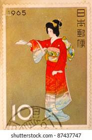 JAPAN - CIRCA 1965: A stamp printed in japan shows Geisha, circa 1965