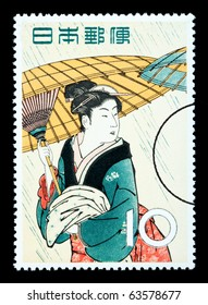 JAPAN - CIRCA 1966: A postage stamp printed in Japan showing a painting of a Japanese woman, circa 1966