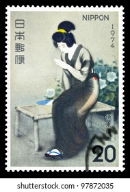"""JAPAN - CIRCA 1974: A stamp printed in Japan, shows a picture """"girl sitting on a bench"""", circa 1974"""