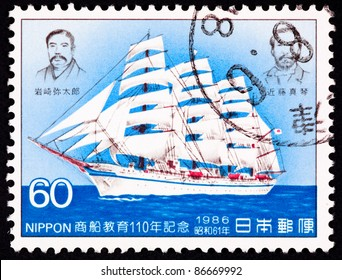 JAPAN - CIRCA 1986:  A stamp printed in Japan shows a Japanese tall ship sailing on the ocean, commemorating 110 years of Japanese merchant marine service, circa 1986.