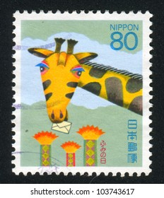 JAPAN - CIRCA 1994: stamp printed by Japan shows Giraffe with Letter, circa 1994