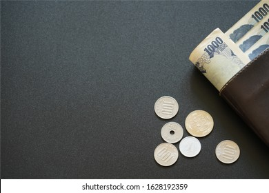Japan currency paper banknote and coins with credit card (prop) in wallet on dark background, banking economic and finance concept, Japanese money savings
