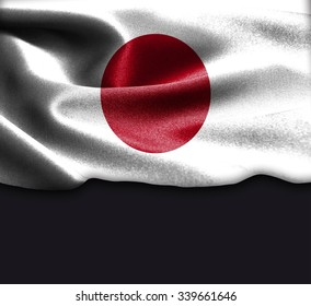 Japan flag on smooth silk texture Dark Background Space for Text