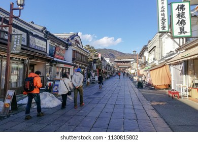 Japan : Jan 2018, Tourists Walk Through The Streets With Shops To Visit Ancient And Famous Zenkoji Temple At Nagano In Winter Season.