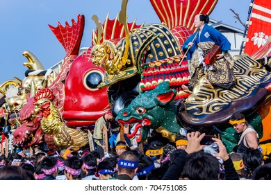Japan. Karatsu. 4 november 2013 Karatsu kunchi festival massive floats in the form of samurai helmets, sea bream, dragons, and other fantastical creatures in line.