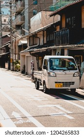 Japan, May 2018: City transportation: Found a random car in empty street in Kyoto.