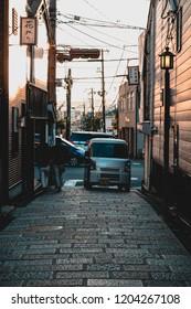 Japan, May 2018: A random car going through an alley in Osaka.