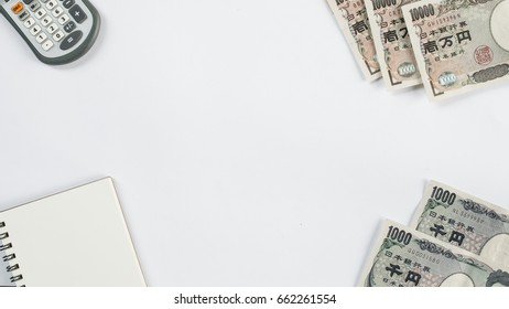 Japan money - Japanese yen currency and Calculator, notebook on white background ( Space and composition for text )