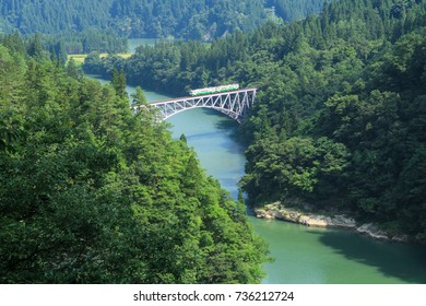 Japan mountain and river with local train in summer season at Mishima town , Fukushima prefecture