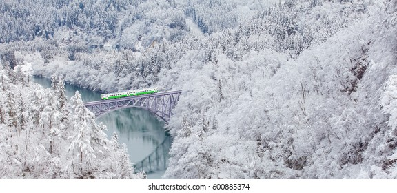 Japan mountain and snow with local train in winter season at Mishima town , Fukushima prefecture