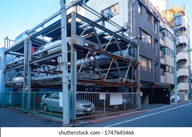 Japan. Multi-level Parking in Tokyo. Multi-storey car Park. Cars are parked in a Parking lot in a Japanese city. Automated Parking for cars. Saving urban space in Japan. Rational use of space.