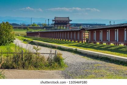JAPAN, NARA - APRIL 23, 2017: Suzaku Gate of Heijo Palace in Nara behind perimeter walls