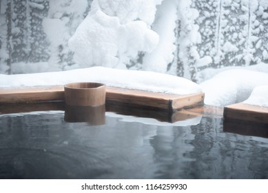 Japan natural mineral hot spring called onsen cover by snow in Japanese ryokan on the moutain okuhida takayama japan
