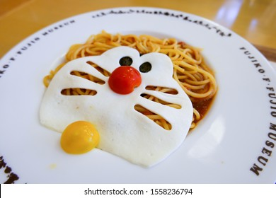 JAPAN - OCT 20, 2019: Doraemon delicious spaghetti dish show red nose and yellow bell made of tomato on cute cat face and big eyes in Doraemon restaurant, Fujiko F Fujio Museum, Kawasaki, Tokyo