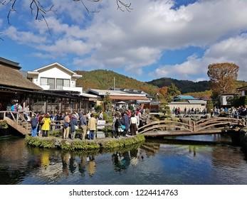 Japan, Oshino Hakkai - 28 October 2017 : Tourist go to Oshino Hakkai, a small village with 8 clear ponds  in Fuji Five Lake area, views of Mountain Fuji.