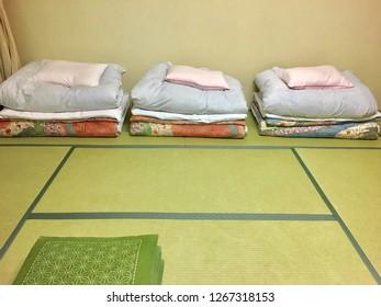 Japan ryokan with blanket and pillow on green Tatami
