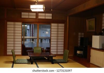 Japan ryokan room with door open and light lamp