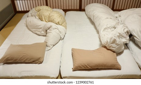 Japan ryokan and unfold white and brown blanket after wake up in the morning