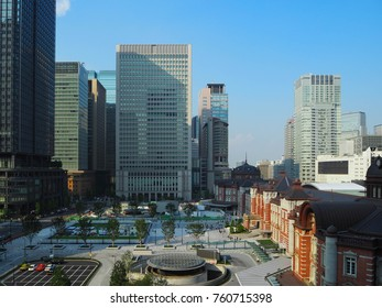 Chiyoda-ku?Tokyo /Japan - September 26 2017: Marunouchi station building of Tokyo station restored to the figure of the 1900s. Modern high-rise buildings are lined up in the surrounding area.
