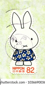 Japan special shaped stamp no circa date: a stamp printed in Japan shows Miffy rabbit, by Dick Bruna.