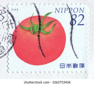 Japan stamp no circa date: a stamp printed in Japan shows a red tomato illustration.
